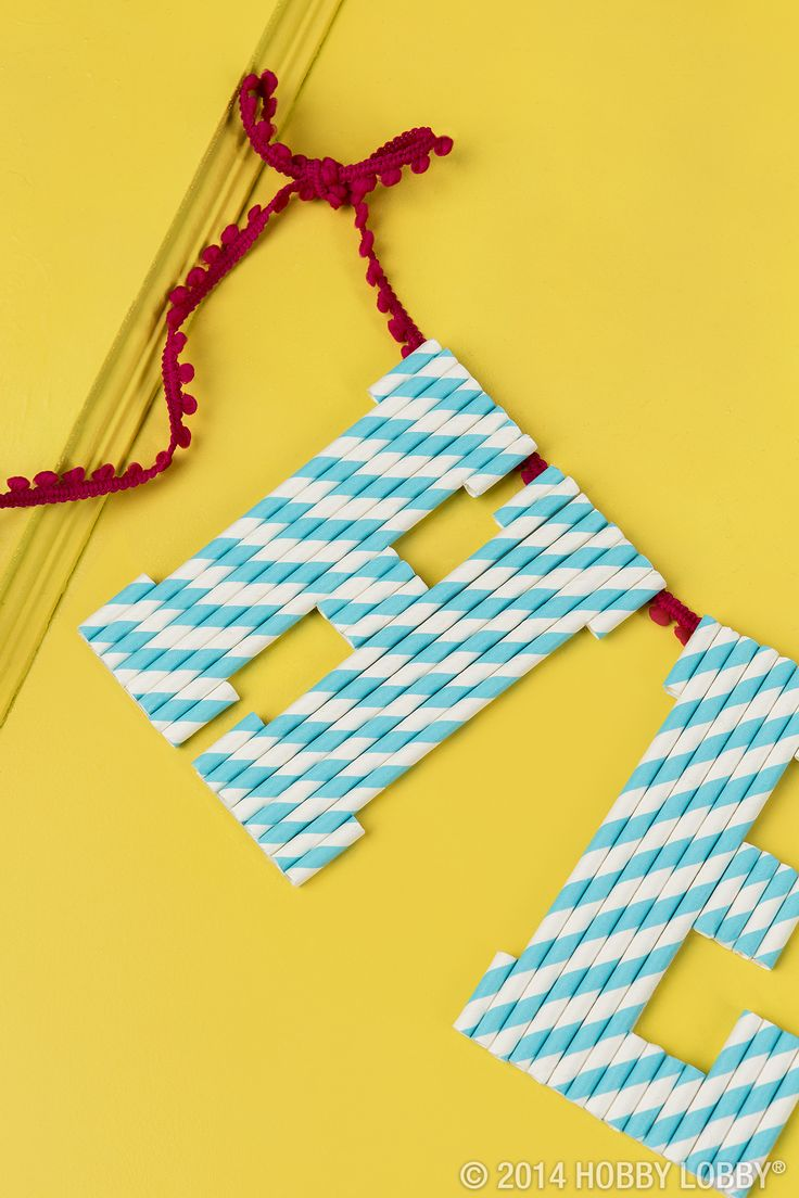 Use paper straws to create a fun and playful greeting for an entryway or party banner!  Simply cut the straws to the right length and glue onto cardboard letter cutouts.