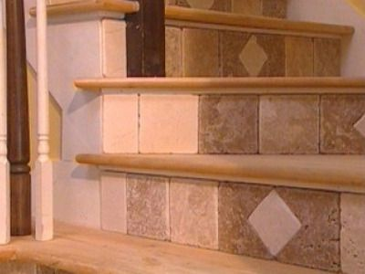 How to tile stair risers...but I would like to use river pebble tiles maybe