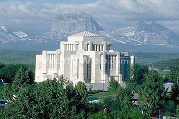 Cardston Alberta Canada temple with big chief mountain in the background.  This is my most favorite temple of all I've been through.