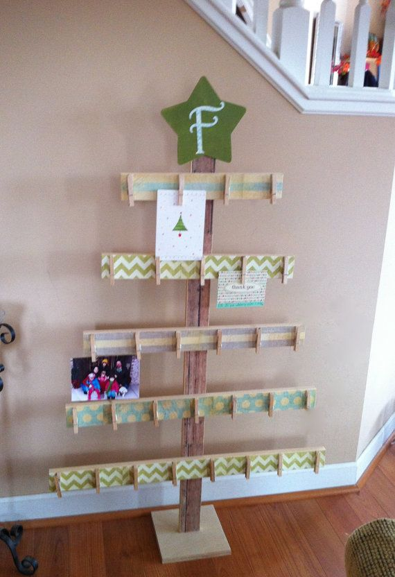 This Christmas card holder is shaped like a tree and is made of wood. The tree card holder is approximately 4ft tall. The branches are 32 wide-16