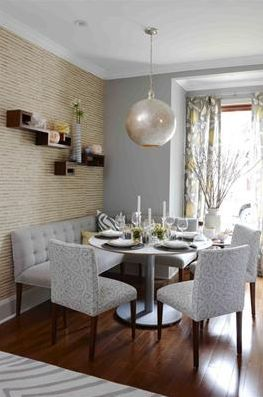 Transitional grey and beige dining room with textured wallpaper, mercury glass pendant, and tufted upholstery