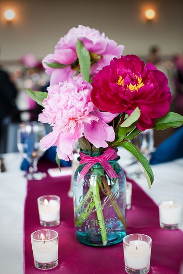 Mason jar centerpiece with hot pink and blush pink flowers