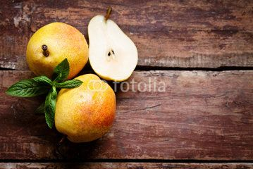 Ripe pears with mint on the wooden table