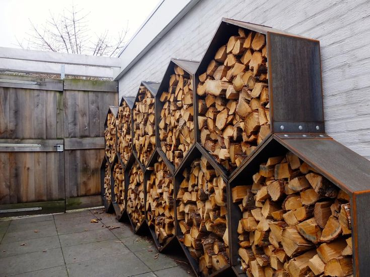 Backyard with octagon firewood racks.