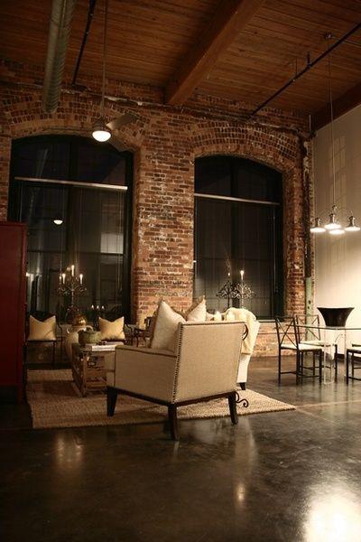 Exposed brick walls, wood ceilings, concrete floor