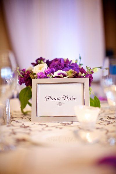 Instead of numbers, designate tables by different types of wine, flowers, cities, or favorite books. I love simple ideas like this to add a personal touch to your wedding!