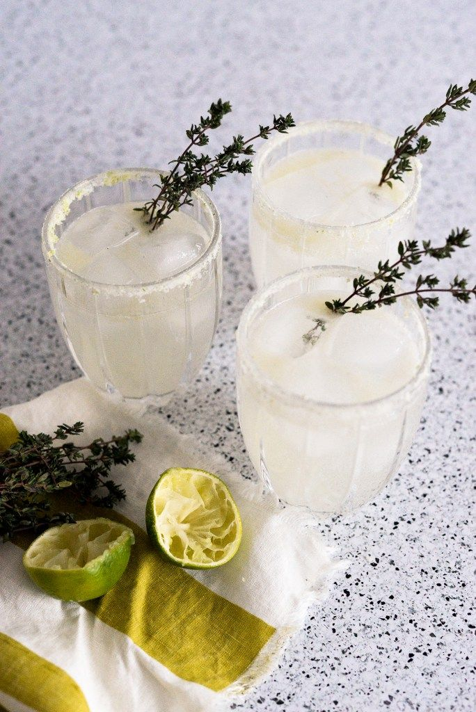 Refreshing Gin Cocktail with Thyme and Lime | I had gin, thyme, a couple of limes, and some grapefruit Perrier. The result was so delicious that I made it again to share here! This drink is fresh, punchy, and herby. @ThreadsnBlooms