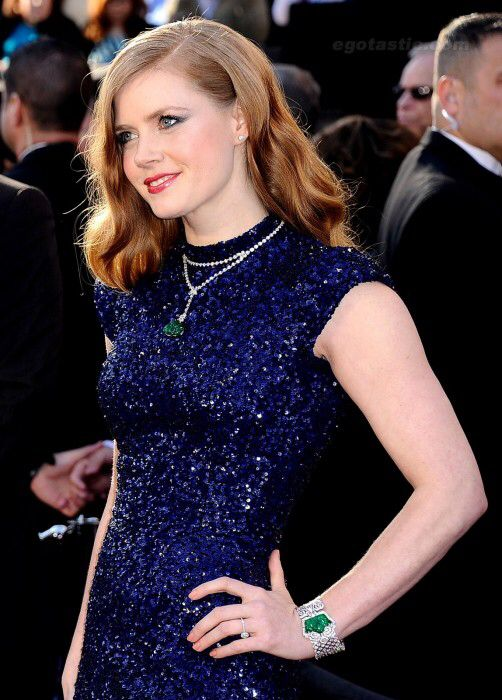 Amy Adams chose Cartier for the 2011 Oscars, wearing a carved emerald and diamond necklace with a matching carved emerald and diamond secret watch, both from Cartier. Together, the jewels are valued at about $1.3 million.