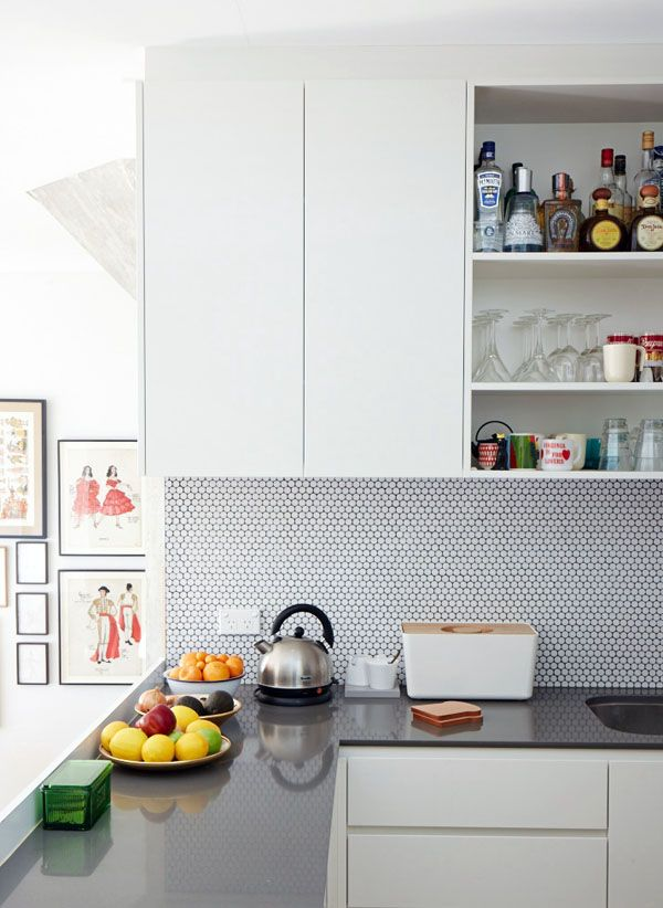 Wallsandfloors.co.uk - gloss white hexagon tiles. White hexagon mosaic tiles in a white kitchen [The Design Files]