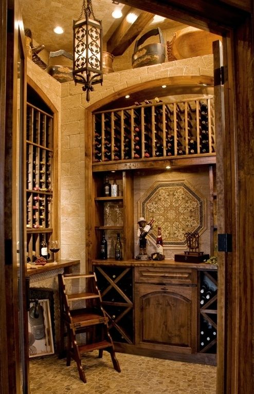 Mediterranean Wine Cellar with Pendant light, slate floors, Riedel Vinum XL Oaked Chardonnay 4 Piece Value Set, High ceiling