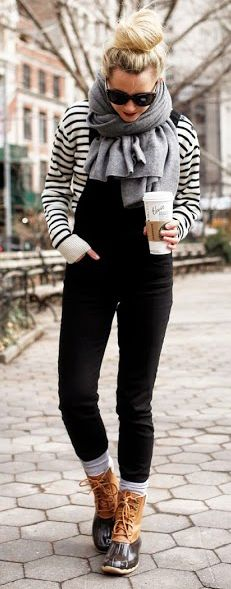 Black dungarees with a black and white long-sleeved striped top, a really good look for the weekend. Paired with a scarf you can wear it for wandering around a market in the fall. Just pull on your favorite boots and you're good to go!