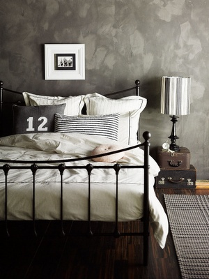 Moody greys here are great. I love how that back wall looks. The bed looks really clean too but the grey pillows make it look a bit more worn and not so rigid like plain white usually looks.