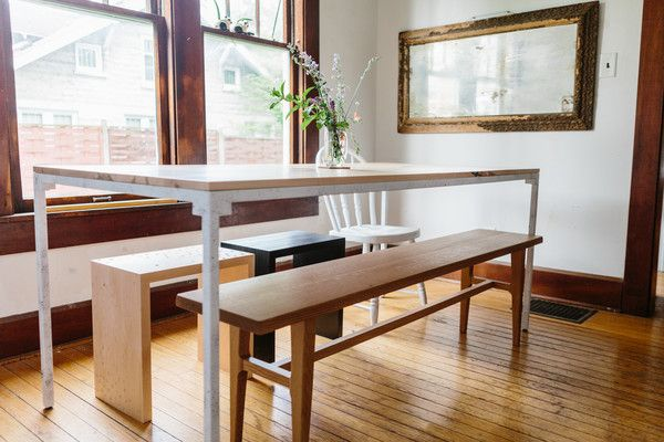 A contemporary dining space with rustic accents and a wooden dining table and benches.
