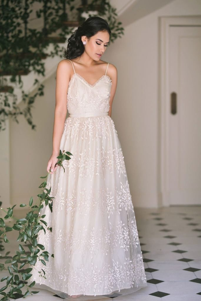 74a3eaec787 This gorgeous beaded and embroidered gown is a great option for your next  special occasion.