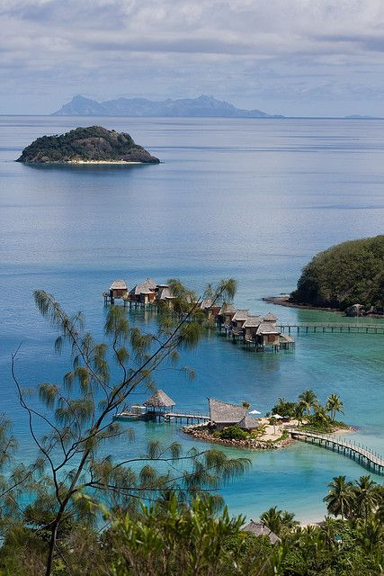 Likuliku Lagoon Resort in Fiji Islands (by Neets & Dre). OR this would be a lovely vacation spot.