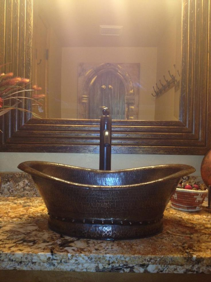 Premier Copper Products New Bath Tub Copper Vessel Sink is beautifully installed with the Tru Vintage Vessel Faucet.  Item Numbers: VBT20DB and B-VF01ORB.