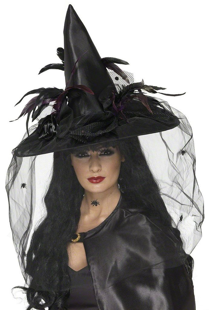 scattered spiders crawling around the perimeter for a dramatic look. Our Deluxe Black Witch Hat with Veil will beautifully compliment a variety of fancy witch costumes for a fun Halloween night. One size fits teens and adults.