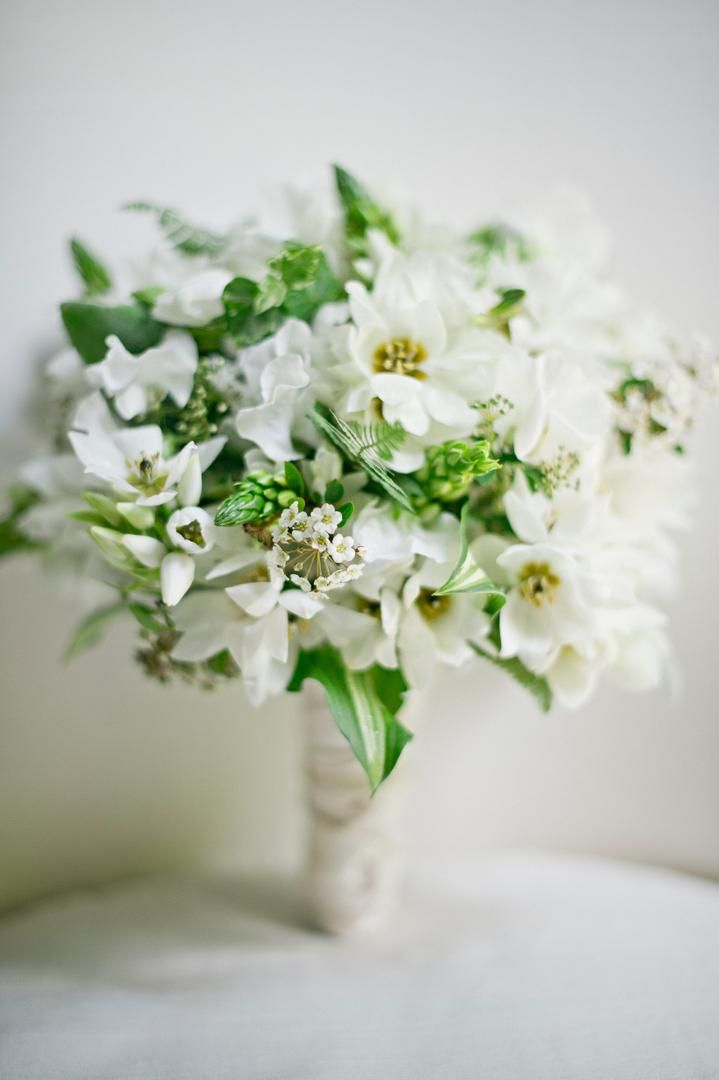 The bride's bouquet was composed of delicate greenery and white Star of Bethlehem blooms and wrapped with braided silk ribbon. #whitebouquet Photography: Harwell Photography. Read More: http://www.insideweddings.com/weddings/romantic-woodland-inspired-atlanta-wedding-with-natural-details/433/