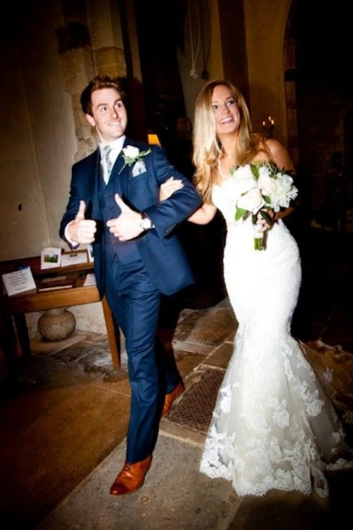 The grooms navy suit with brown shoes and the brides dress and bouquet... perfect