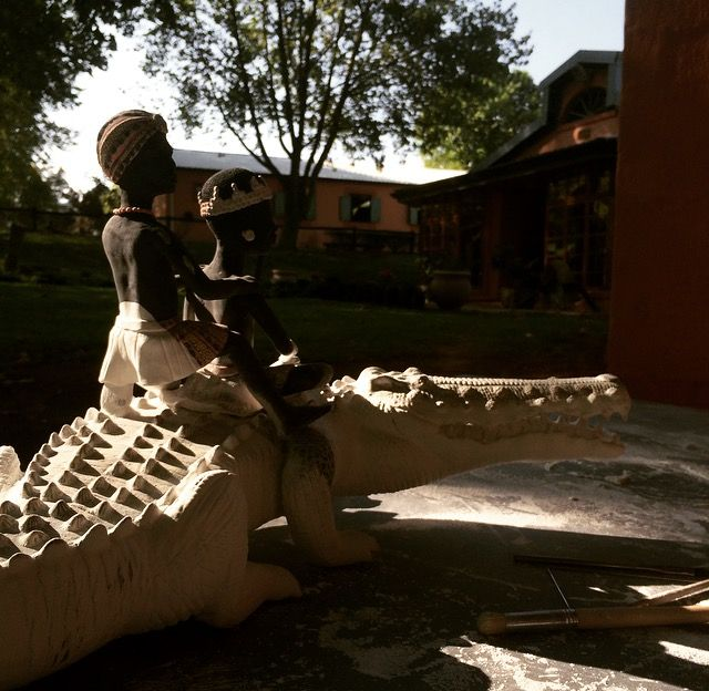 An Ardmore Crocodile and Rider in the process of being glazed at the studio.