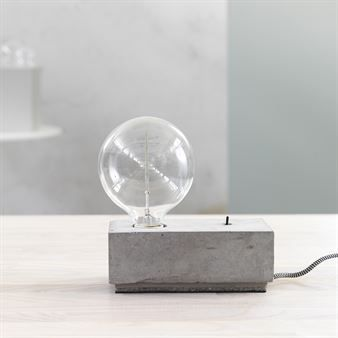 Stella table lamp concrete square from Care of Bankeryd is a unique lamp that will become an eye-catcher even though the design is very simple.