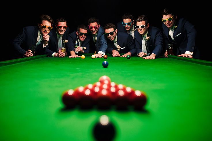Groomsmen in the Snooker Room during a wedding at Orchardleigh House in Frome