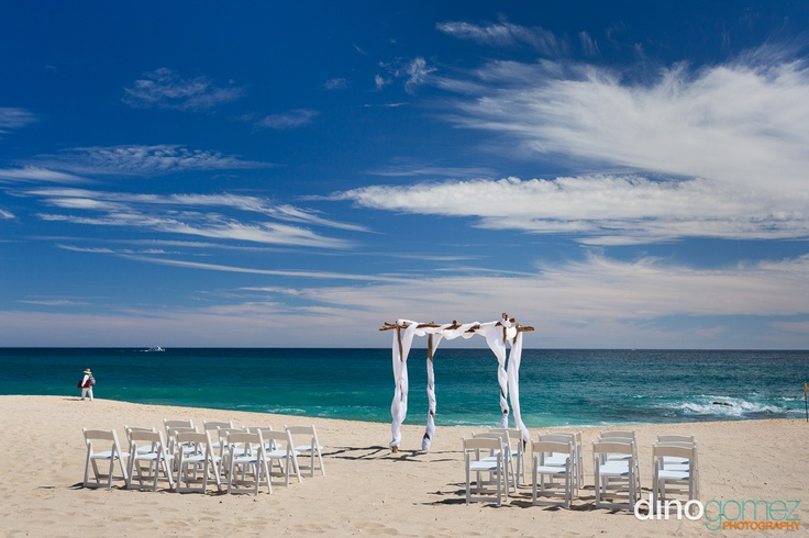 Clean and simple beach wedding setup featuring rustic, draped chuppa + The Main Event Cabo!! Los Cabos Wedding Photographer Dino Gomez