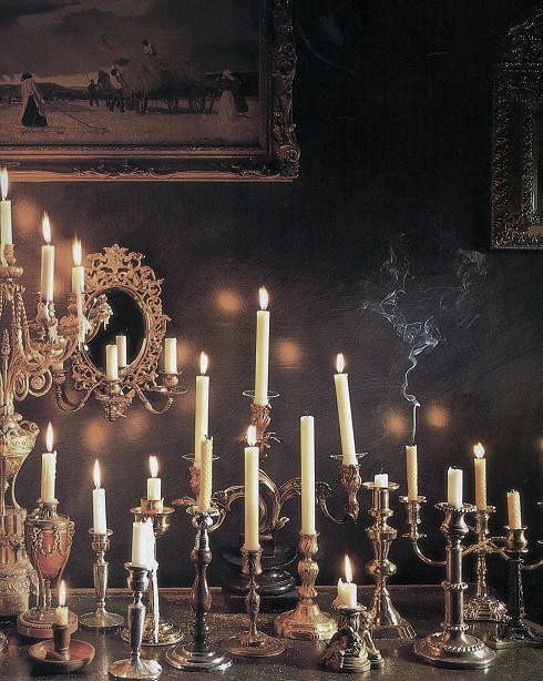 I like to use cream candles, instead of black in my silver candleholders for halloween, then they can be re used for christmas.