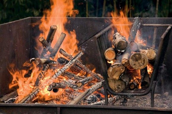 The seven fires of Argentinian asado | Parilla: cast iron barbeque grate over hot coals that have fallen from an adjacent basket of burning wood and been pushed underneath. Chapa: cast iron griddle pan. Infiernillo: cast iron griddle pans between one fire above and another below. Horno de barro: wood-fired oven. Rescoldo: ingredients directly covered in hot embers. Asador: butterflied carcass on a cast iron support with at least two cross pieces. Caldero: cast iron kettle or dutch oven.