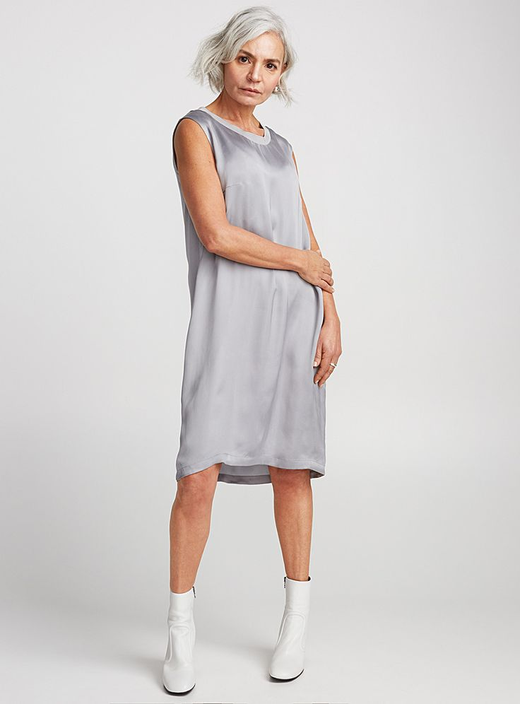 - Drykorn collection from Germany at Contemporaine - Ultra chic dress with athletic flair featuring a sleeveless sheath design and ribbed round neck - High-low hem - Very light and fluid, satiny weave The model is wearing size 2 Length: 93cm, from the top of the shoulder