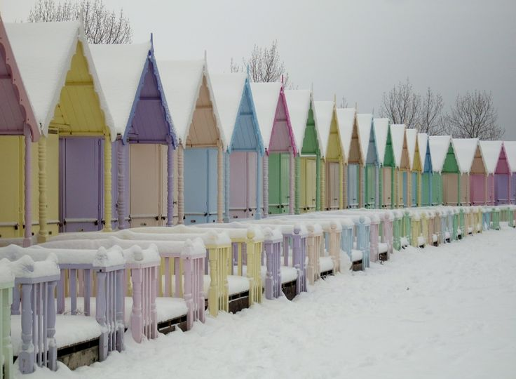 Snow-covered, pastel-coloured beach huts at West Mersea! =)