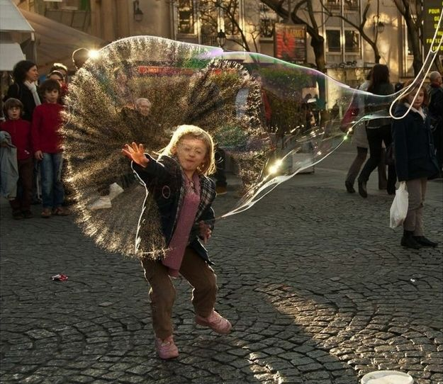 The moment a huge bubble bursts in Paris, France.