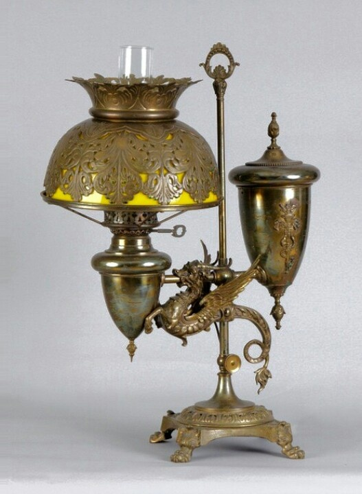 This oil desk lamp dates from the 1870's.
