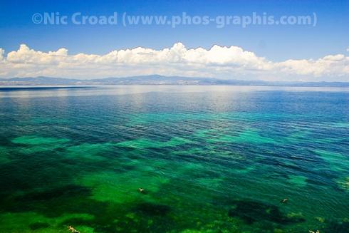 The clear green sea of Nea Fokea, Kassandra, Chalkidiki, Greece. Photographer: Nic Croad