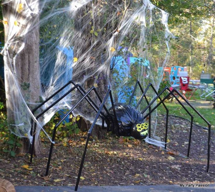 huge spider made from pvc pipe spray paint and garbage bags family haunting halloween party