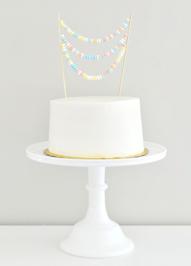 Make candy necklaces look surprisingly impressive. | 16 DIY Ways To Take Your Store-Bought Cake To The Next Level