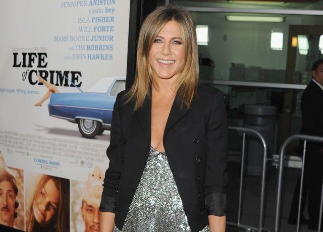 Jennifer Aniston enjoys 'stiff drink' as Brad and Angelina wedding news breaks