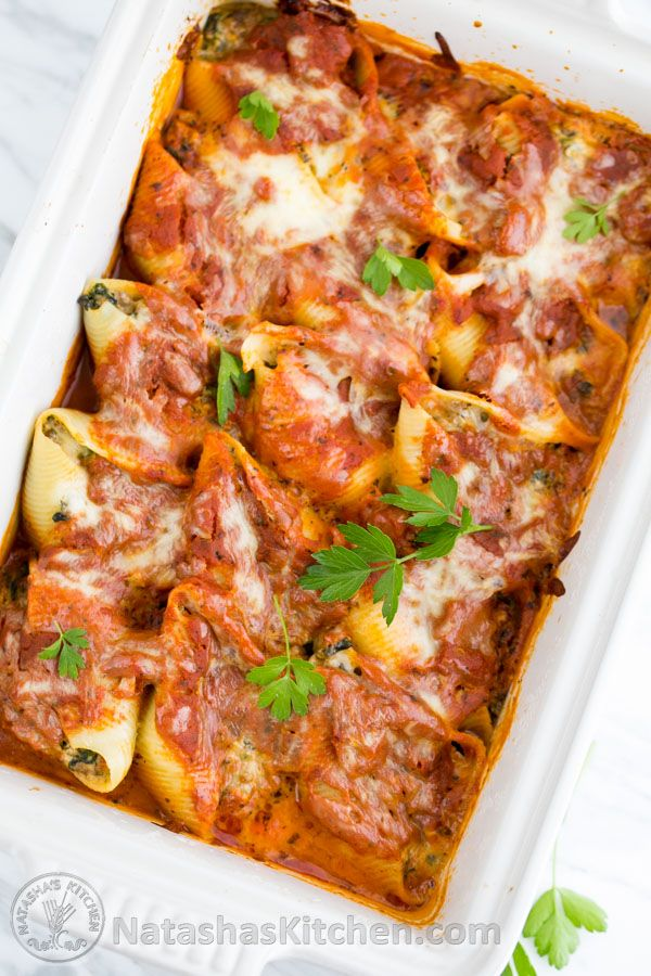 These lasagna stuffed shells are easier than making lasagna but are just as satisfying! @natashaskitchen