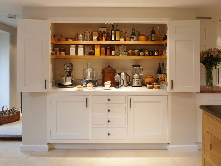 Tuck a worktop in a cupboard  Consider making room for a bench within your cupboard or pantry. This large cupboard provides a worktop and ample storage for food and appliances. Floating shelves don't impede the work space and bifold doors hide away the clutter. It's also great if you can position it in the dining room as a prep zone, or in the hallway, to save on essential space in the kitchen.