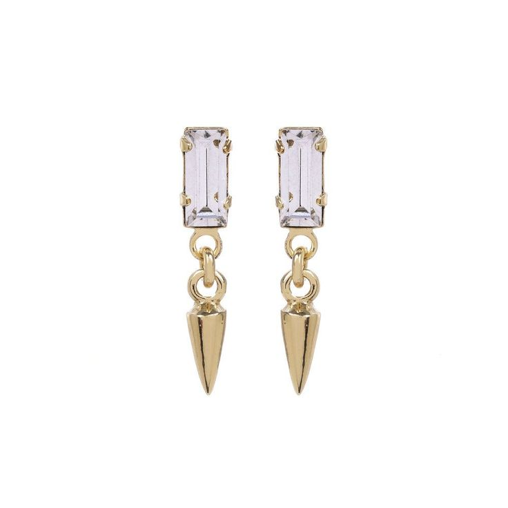 A sweet mix of sparkle and fierceness, these mini drop earrings feature a glittering Swarovski baguette crystal and a tiny bullet charm. From our best selling '