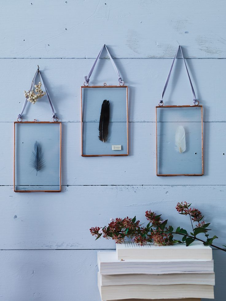 """Add instant charm to your living room, bedroom or hallway with this beautiful set of three metal-rimmed frames. Each of these three frames comes with soft velvet ribbon for hanging and space for photos measuring up to 4"""" x 6""""; a truly inspired way to display some of your favourite pictures and mementos. These delicate frames are available in a stylish copper or silverfinish, and make beautiful gifts."""