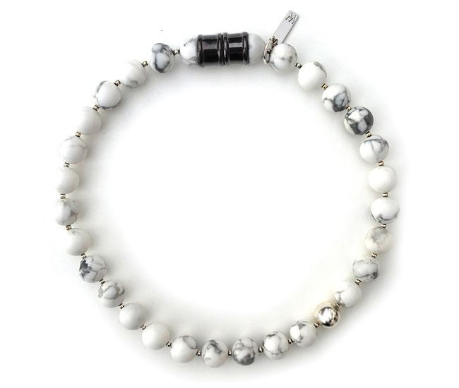 Add a hit of rock star–edge to any outfit. To create this marble choker, Torontonian Emily Woudenberg strings together 12-millimetre stone beads, offset with sterling silver spacers. A magnetic clasp completes the necklace.