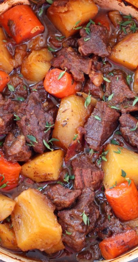 Flavorful Beer Braised Beef with Carrots and Potatoes ~ Cooked slow and low in the oven... One bite of this tender, juicy, tad spicy beef is going to send you over the moon.