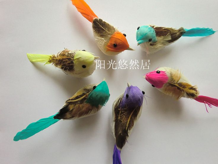 Bird feathers bird ornaments and garden decorations on for Feathered birds for crafts
