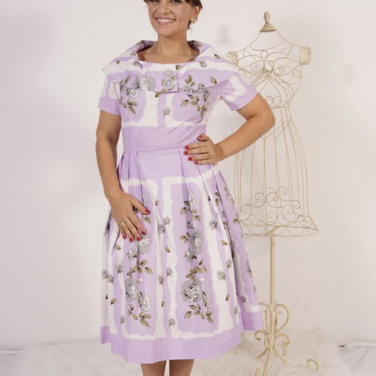 Judy Lilac Print Dress Med - Vintage Inspired In a crisp vintage style cotton this dress has a standout wide shawl collar featuring 2 large pearly vintage 60's buttons at the front. The print has grey, white and black roses on a lilac background within large white borders. A tiny pleat at the side front of the collar ensures that it sits up rather than lying flat across the shoulders.  Purchase AUD$139.00 (Free Postage within Australia)