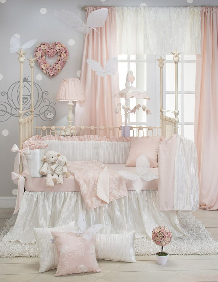 Create the perfect nursery for your little princess! Elegant crushed satin crib skirt is magically textured like ripples on water. Ultra fine sheer netting is embroidered with dimensional chiffon cut flowers in antique white. Lined with gorgeous silk-like fabric the color of petals, the quilt is finished with petite ivory piping. Super soft cream quilt back is soothing and comforting. All fabrics have a subtle sheen for a beautiful play of light. Wide satin ribbon bumper ties accent ...