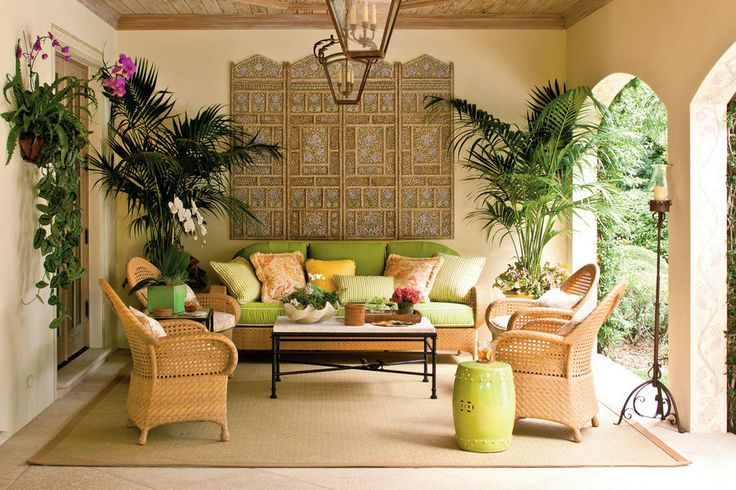 Lush Loggia Patio - 80 Breezy Porches and Patios - Southernliving. Miami designers Mimi McMakin and Ashley Sharpe of Kemble Interiors were inspired by the surrounding gardens and vintage Palm Beach style when they created this tropical patio.  See more of this Lush Loggia Patio