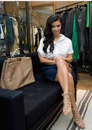 Star Kim Kardashian is wearing a black skirt and the #Fendi #PeekABoo handbag color Tortora Rent it you too on www.rentfashionbag.com  RENT, DON'T BUY AND SAVE BIG!