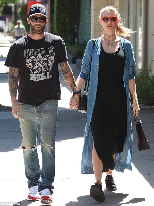 Perfect pair:Adam Levine and Behati Prinsloo were the picture perfect parents-to-be as th...