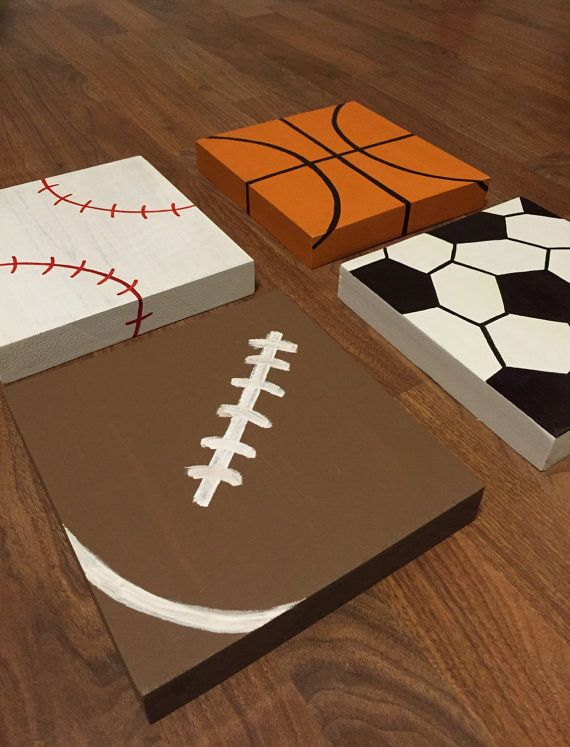 Set of 4 wood sports signs handcrafted and painted this set includes one football, one soccer ball, one baseball, and one basketball.  Perfect for